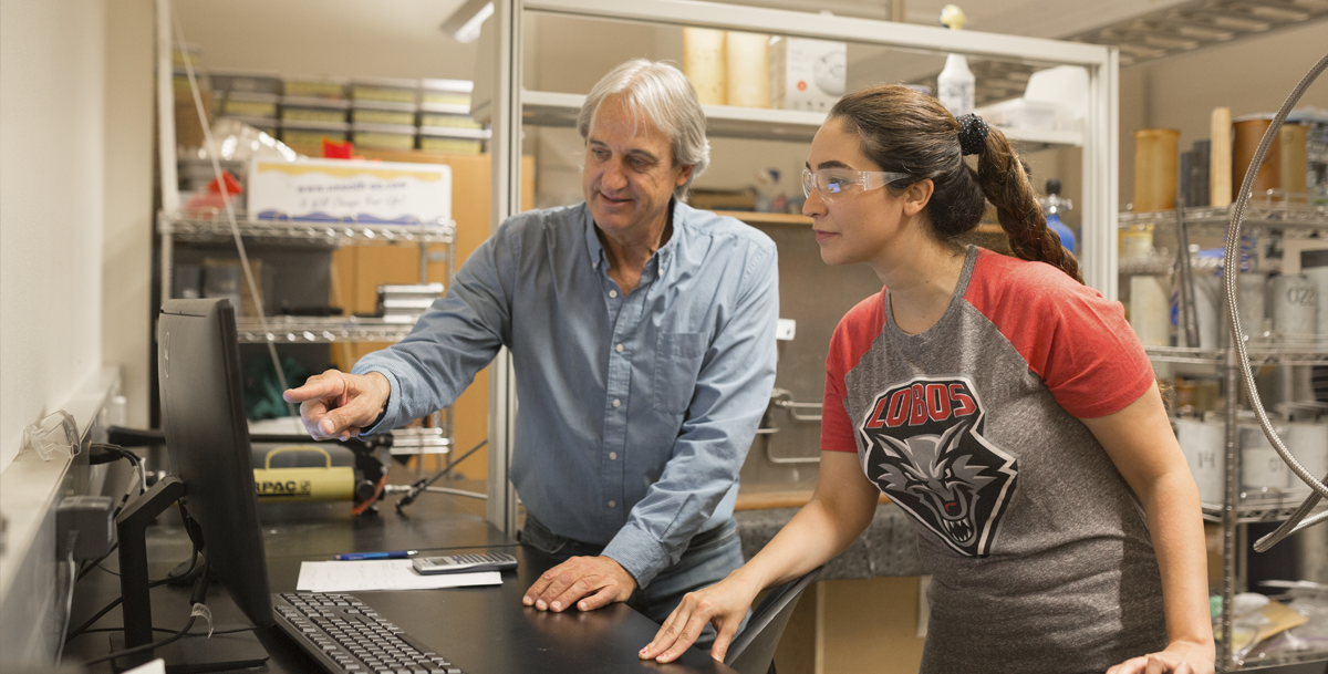 photo of a faculty member working with a student in a lab